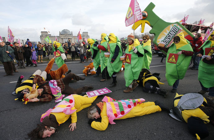 German farmers and consumer rights activists performs as they take part in a march to protest against the Transatlantic Trade and Investment Partnership (TTIP), mass husbandry and genetic engineering in Berlin