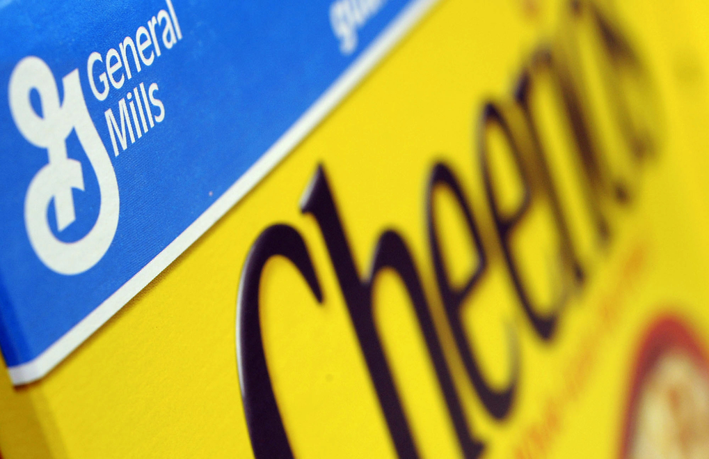 FILE - In this Dec. 15, 2007 file photo, a box of General Mills' Cheerios is seen on a shelf at a Shaw's Supermarket in Gloucester, Mass.  General Mills says it will start labeling products across the country that contain genetically modified ingredients to comply with a law that is set to go into effect in Vermont. The maker of Cheerios cereal, Progresso soups and Yoplait yogurt notes it is impractical to label its products for just one state, so the disclosures required by Vermont starting in July 2016 will be on its products throughout the U.S. (AP Photo/Lisa Poole, file)