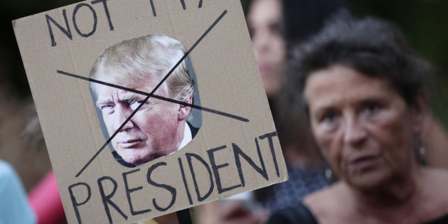 A demonstrator protests against the visit of U.S. President Trump in Rome XXSTRINGERXX XXXXX / REUTERS